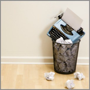 what is writer's block? trashcan with typewriter and paper, depicting writers block